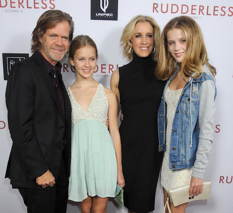 "LOS ANGELES, CA - OCTOBER 07: William H. Macy, Georgia Grace Macy, Felicity Huffman and Sophia Grace Macy arrive at the Los Angeles VIP Screening of ""Rudderless"" at the Vista Theatre on October 7, 2014 in Los Angeles, California. (Photo by Gregg DeGuire/WireImage)"