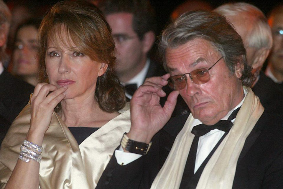 French actors Alain Delon and Nathalie Baye attend a ceremony in honor of French producer Daniel Toscan du Plantier 04 October 2003 at the Al Badii Palace in Marrakech during the third Marrakech Film Festival.        AFP PHOTO/ABDELHAK SENNA   (Photo credit should read ABDELHAK SENNA/AFP via Getty Images) (Photo: AFP via Getty Images)