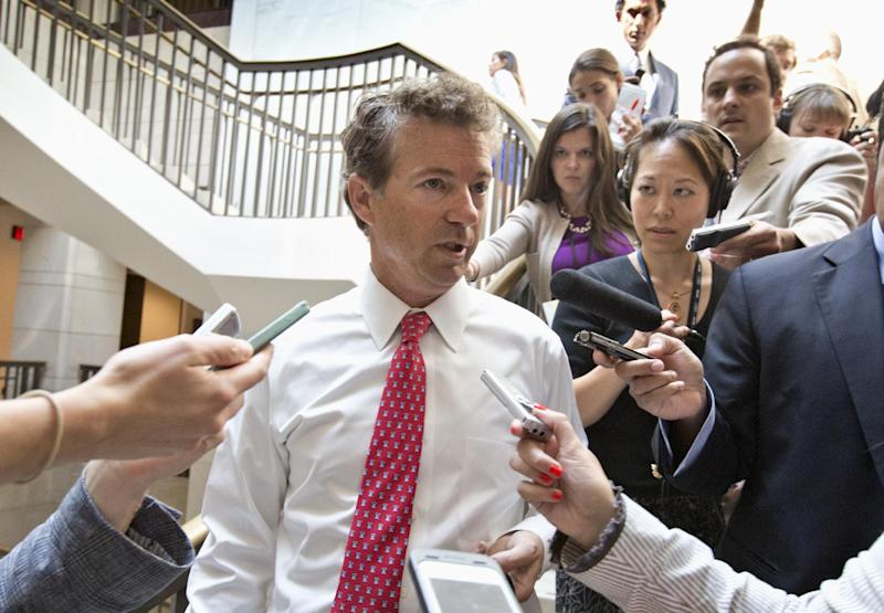 Sen. Rand Paul, R-Ky., a member of the Senate Foreign Relations Committee, talks to reporters on Capitol Hill in Washington, Tuesday, Sept. 3, 2013, as he arrives for a joint Senate and House intelligence briefing on Syria behind locked doors. President Barack Obama is requesting congressional authorization for military intervention in Syria in response to last month's alleged sarin gas attack. (AP Photo/J. Scott Applewhite)