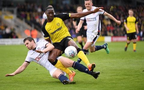 "Nigel Clough hopes Burton Albion have not timed their impressive dash for Championship safety too late. Goals from Hope Akpan and Luke Akins booked a convincing victory over Bolton Wanderers, who themselves sunk deeper into the relegation mire. Burton – who have the lowest wage budget in the second tier - have been in the bottom three since Boxing Day, and remain so on goal difference, but their pragmatic manager knows his team may still require favours on the last weekend as they travel to Preston North End. ""For a team which hadn't won in six months at one point, that wasn't bad,"" smiled Clough. ""But we know we have still got a lot of work to do, and that we can't afford to lose next week. We lose at Preston, we are down, so we go to Preston with the same sort of attitude. ""It would have been nice to be out of the bottom three. But of course you only have to be out of it on the final day. Jon Flanagan and Lucas Akins battle for the ball Credit: GETTY IMAGES ""The lads have got a great spirit and they are up for it. We knew what we had to do after the Hull game; win three and draw one minimum. We have got three and now we are going to try and win the game next week."" Bolton have endured a miserable time away from home this season, winning just one of their 23 games since returning to the Championship. It is little wonder with the weak defending produced in the first half as the Brewers secured a two-goal lead before half time. Hope Akpan finished off an intricate move to score his first Brewers goal on 28 minutes and it was not long before more dithering by Derik Osede and Mark Beevers allowed Lucas Akins to stab in the second just before half time. Fighting broke out among travelling supporters, a small group even trying to confront Bolton boss Phil Parkinson before stewards blocked their path. Such passion, however misguided, was in short supply among the Bolton players. Burton's determination to hold on to their Championship status was only let down by their finishing. Liam Boyce, Marvin Sordell and Akins all spurned opportunities to make the margin of victory more extravagant. Bolton, who drop to second-bottom, now require a win against Nottingham Forest next weekend and hope other clubs around the bottom three drop points. ""I can't do anything else but apologise for that performance to our supporters,"" said Parkinson. ""I can understand their anger. I share it. We simply were not good enough and Burton were better than us all over the pitch. ""Believe me, no-one is hurting more than me and my staff at this moment in time. ""Once we had gone two goals down there was nothing to suggest we could get back into the game and that is bitterly, bitterly disappointing. ""All we can do is pick ourselves up and try to get something from the game next weekend and hope it is enough."""