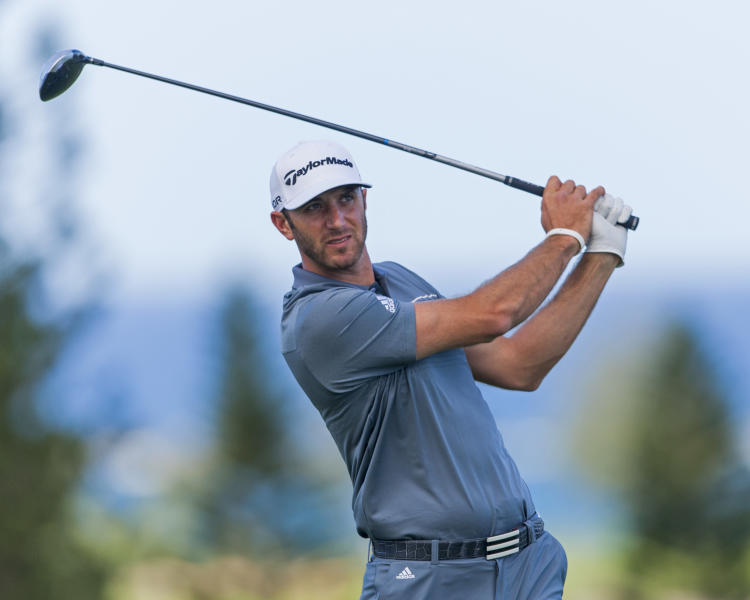 Dustin Johnson follows his drive off the ninth tee during the second round of the Tournament of Champions golf tournament, Saturday, Jan. 4, 2014, in Kapalua, Hawaii. (AP Photo/Marco Garcia)