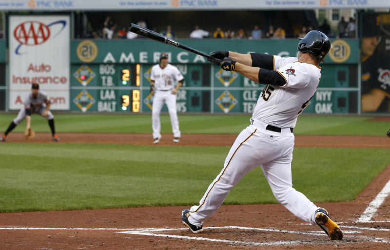 Pittsburgh Pirates' Gerrit Cole hits a single with the bases loaded in his first major league at bat, driving in two runs in the inning of the baseball game against the San Francisco Giants on Tuesday, June 11, 2013, in Pittsburgh. (AP Photo/Keith Srakocic)