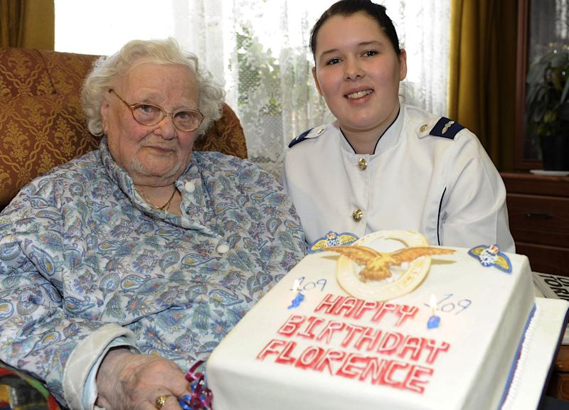 In this Feb. 19, 2010 photo released by the British Ministry of Defense, MOD, shows Florence Green, left, on her 109th birthday being presented with a birthday cake by LAC Hannah Shaw on behalf of the RAF at her home in King's Lynn, east England. Florence Green, the world's last known veteran of World War I, has died at the age of 110, the care home where she lived said Tuesday.     (AP Photo/Sac Chris Hill/MoD, HO) NOTE TO EDITORS: This handout photo may only be used for editorial reporting purposes for the contemporaneous illustration of events, things or the people in the image or facts mentioned in the caption. Reuse of the picture may require further permission from the copyright holder.
