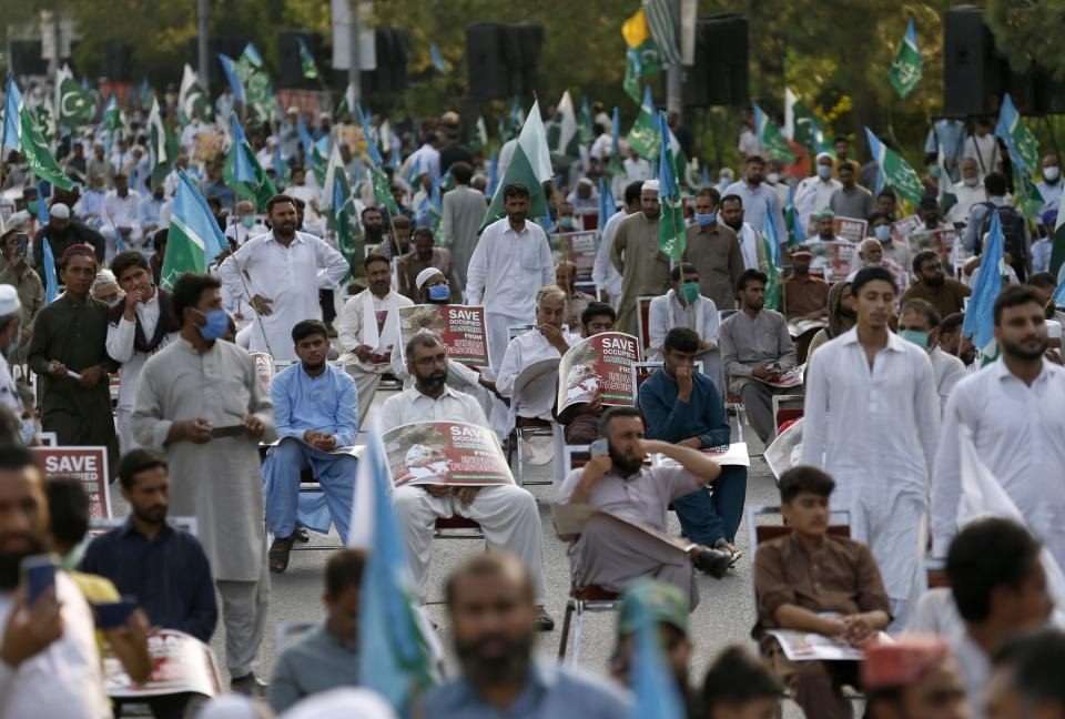Supporters of a religious group Jamaat-e-Islami take part in a rally to show solidarity with the Kashmiri people on the eve of first anniversary of India's decision to revoke the disputed region's semi-autonomy, in Islamabad, Pakistan, Wednesday, Aug. 5, 2020. Last year on Aug. 5, India's Hindu-nationalist-led government of Prime Minister Narendra Modi stripped Jammu and Kashmir's statehood, scrapped its separate constitution and removed inherited protections on land and jobs. (AP Photo/Anjum Naveed)