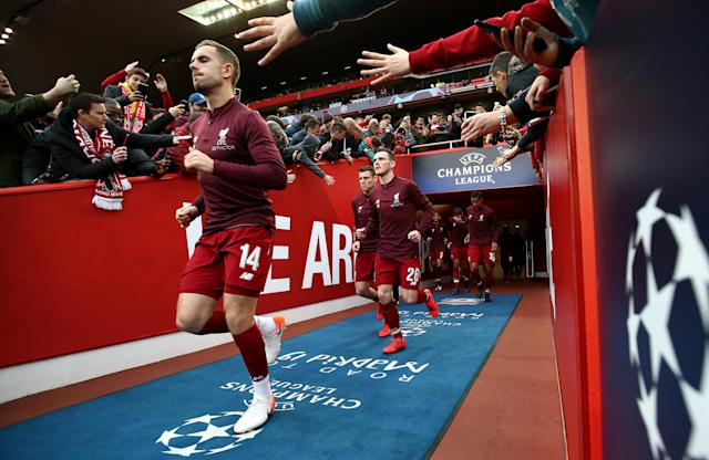 Jordan Henderson of Liverpool leads his team out for warm up during the UEFA Champions League Semi Final second leg match between Liverpool and Barcelona at Anfield on May 07, 2019 in Liverpool, England. (Photo by Jan Kruger - UEFA/UEFA via Getty Images)