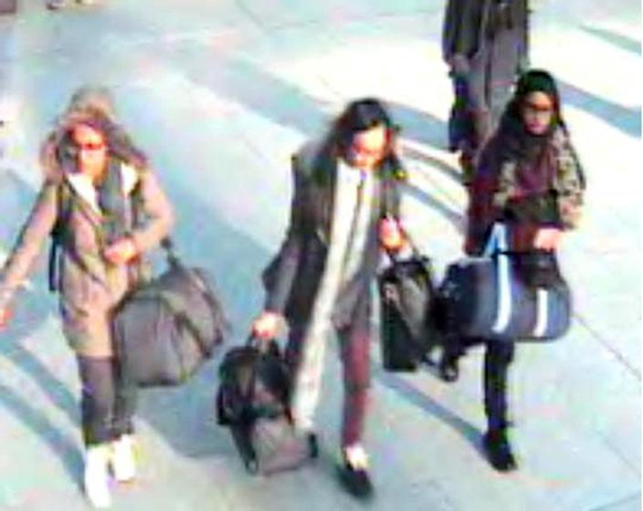 15-year-old Amira Abase, Kadiza Sultana, 16, and Shamima Begum, 15, at Gatwick airport on their way to Syria in February 2015 (PA)