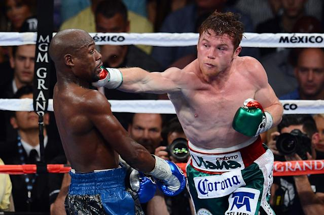 Canelo Alvarez throws a right at Floyd Mayweather Jr. during their WBC/WBA 154-pound title fight at the MGM Grand Garden Arena on Sept. 14, 2013 in Las Vegas. (Ethan Miller/Getty Images)