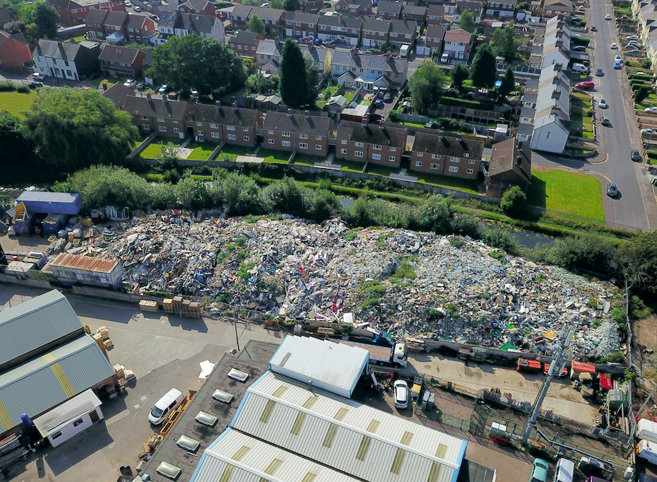 The 32ft mountain of rubbish was dumped near homes in Willenhall, West Midlands. (SWNS)