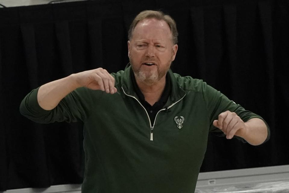 Milwaukee Bucks head coach Mike Budenholzer reats during the first half of Game 1 of their NBA basketball first-round playoff series against the Miami Heat Saturday, May 22, 2021, in Milwaukee. (AP Photo/Morry Gash)