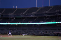 Seattle Mariners' Chris Flexen, bottom left, pitches against the Oakland Athletics during the second inning of a baseball game in Oakland, Calif., Wednesday, Sept. 22, 2021. (AP Photo/Jeff Chiu)