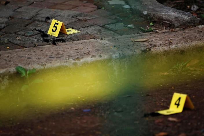 Evidence markers are pictured during an investigation following a blast at National Monument (Monas) complex in Jakarta
