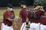 Arizona Diamondbacks starting pitcher Robbie Ray is pulled from the game by manager Torey Lovullo, left, during the fifth inning of a baseball game against the Colorado Rockies, Wednesday, Aug. 26, 2020, in Phoenix. (AP Photo/Matt York)