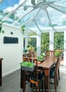 The dining area doubles as a greenhouse!