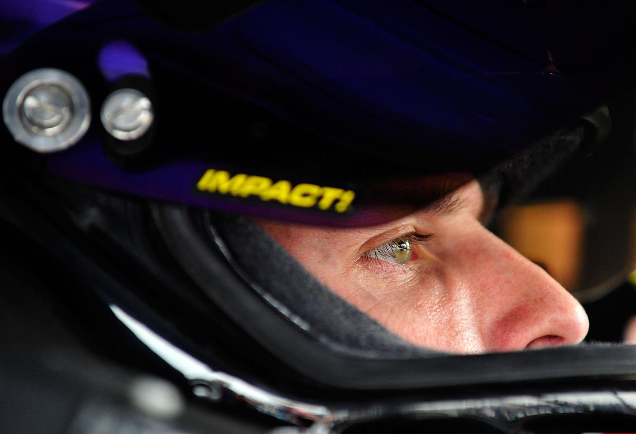 AVONDALE, AZ - NOVEMBER 11:  Denny Hamlin, driver of the #11 FedEx Freight Toyota, sits in his car during practice for the NASCAR Sprint Cup Series Kobalt Tools 500 at Phoenix International Raceway on November 11, 2011 in Avondale, Arizona.  (Photo by Rainier Ehrhardt/Getty Images for NASCAR)