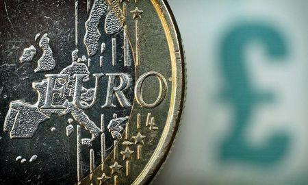 Sterling slides, euro slightly higher at start of big week