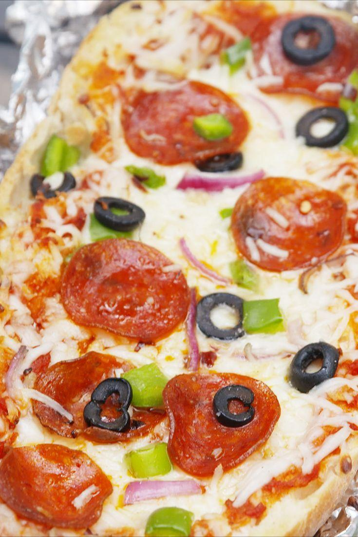 """<p>Yes, you can make pizza over a campfire.</p><p>Get the recipe from <a href=""""https://www.delish.com/cooking/recipe-ideas/recipes/a54636/grilled-pizza-bread-recipe/"""" rel=""""nofollow noopener"""" target=""""_blank"""" data-ylk=""""slk:Delish"""" class=""""link rapid-noclick-resp"""">Delish</a>.</p>"""