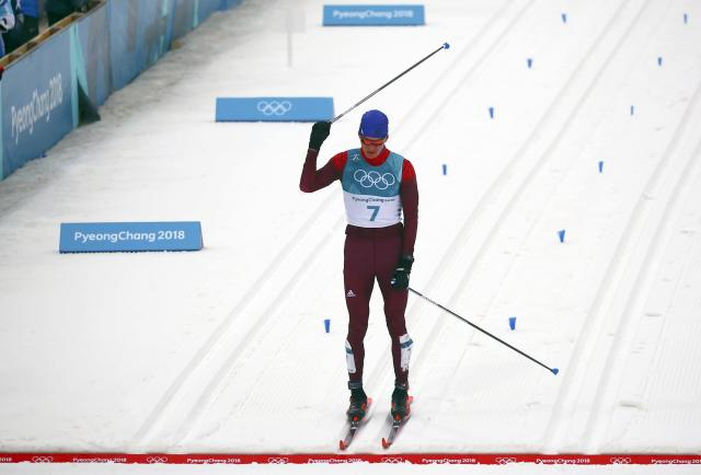 Cross-Country Skiing - Pyeongchang 2018 Winter Olympics - Men's 50km Mass Start Classic - Alpensia Cross-Country Skiing Centre - Pyeongchang, South Korea - February 24, 2018 - Silver medallist Alexander Bolshunov, Olympic athlete from Russia, reacts. REUTERS/Carlos Barria