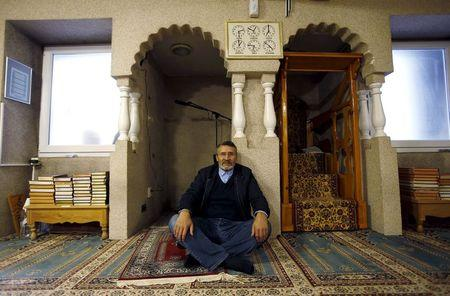 Jamal Habbachich, who heads a council of 22 Molenbeek mosques, poses for a picture at Attadamoun Mosque in the neighbourhood of Molenbeek, in Brussels, Belgium, November 20, 2015. REUTERS/Youssef Boudlal
