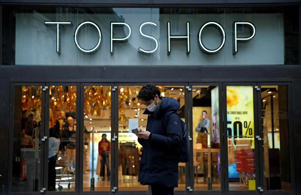 A pedestrian wearing a face covering due to the COVID-19 pandemic, walks past a temporarily closed-down Topshop clothes store, operated by Arcadia, in central London on November 30, 2020. - British clothing retailer Arcadia, ravaged by coronavirus lockdowns and fierce online competition, remains on the brink of bankruptcy despite an emergency loan offer, the BBC reported Monday. (Photo by Hollie Adams / AFP) (Photo by HOLLIE ADAMS/AFP via Getty Images)