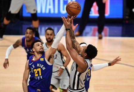 Apr 13, 2019; Denver, CO, USA; San Antonio Spurs guard DeMar DeRozan (10) shoots over Denver Nuggets guard Jamal Murray (27) in the second half in the second quarter in the first round of the 2019 NBA Playoffs at the Pepsi Center. Mandatory Credit: Ron Chenoy-USA TODAY Sports