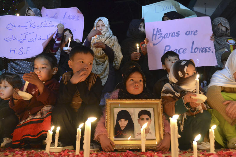 Pakistani children, hold candles during a vigil to condemn attacks on their ethnic Hazara community, in Quetta, Pakistan, Sunday, Feb. 16, 2014. (AP Photo/Arshad Butt)