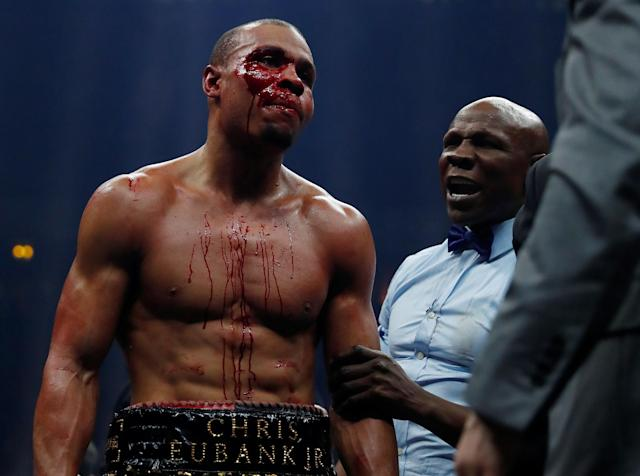 Boxing - World Boxing Super Series Semi Final - George Groves vs Chris Eubank Jr - WBA & IBO World Super-Middleweight Titles - Manchester Arena, Manchester, Britain - February 17, 2018 Chris Eubank Jr with his father Chris Eubank after the fight Action Images via Reuters/Andrew Couldridge