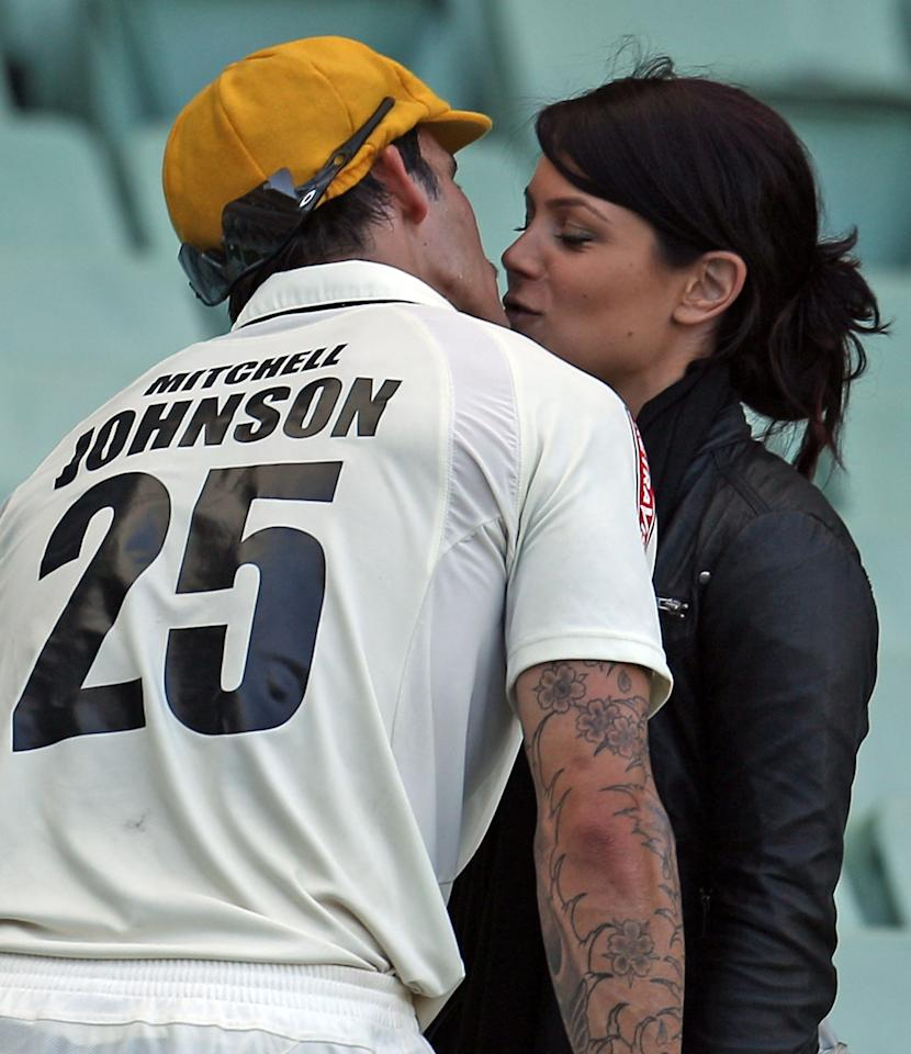 MELBOURNE, AUSTRALIA - NOVEMBER 20:  Mitchell Johnson of Australia is congratulated by girlfriend Jessica Bratich after day four of the Sheffield Shield match between the Victorian Bushrangers and the Western Australia Warriors at Melbourne Cricket Ground on November 20, 2010 in Melbourne, Australia.  (Photo by Scott Barbour/Getty Images)