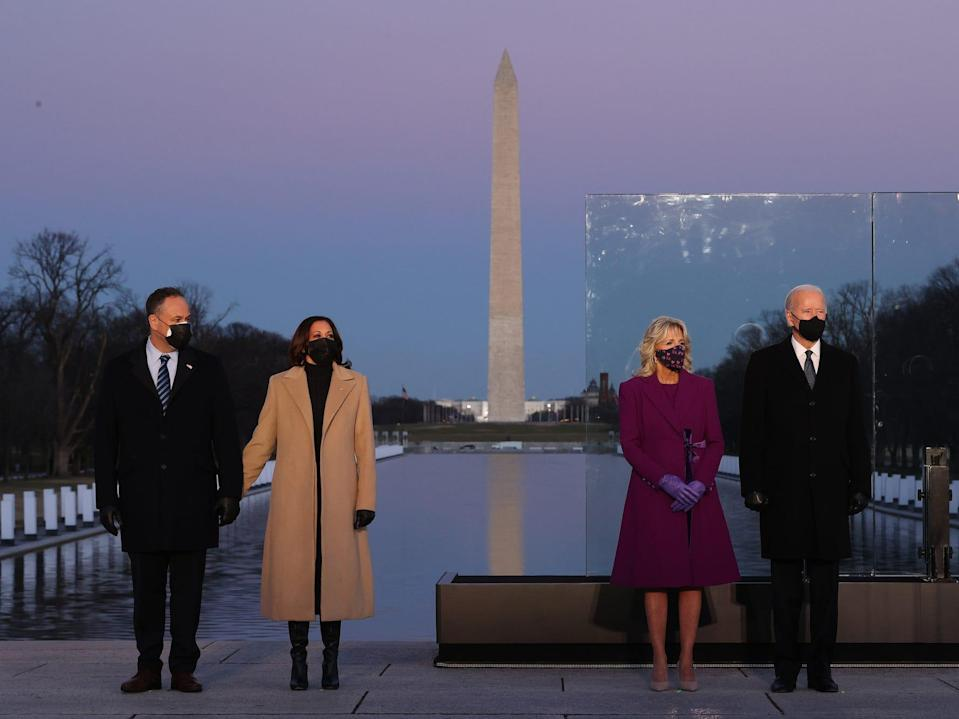 Doug Emhoff, Kamala Harris, Jill Biden, and Joe Biden pose in front of the Lincoln Memorial on the eve of the 2021 Presidential Inauguration.