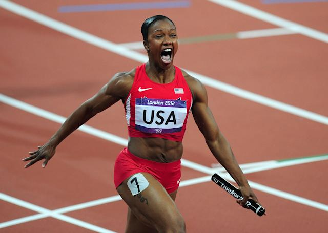 LONDON, ENGLAND - AUGUST 10: Carmelita Jeter of the United States celebrates winning gold in the Women's 4 x 100m Relay Final on Day 14 of the London 2012 Olympic Games at Olympic Stadium on August 10, 2012 in London, England. (Photo by Stu Forster/Getty Images)