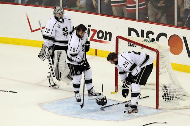 NEWARK, NJ - JUNE 09: Jonathan Quick #32, Jarret Stoll #28 and Dustin Penner #25 of the Los Angeles Kings recover from a scuffle in front of the net against the New Jersey Devils during Game Five of the 2012 NHL Stanley Cup Final at the Prudential Center on June 9, 2012 in Newark, New Jersey. (Photo by Jim McIsaac/Getty Images)