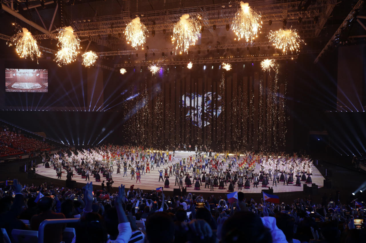 Fireworks display during the opening ceremony of the 30th South East Asian Games at the Philippine Arena, Bulacan province, northern Philippines on Saturday, Nov. 30, 2019. (AP Photo/Aaron Favila)