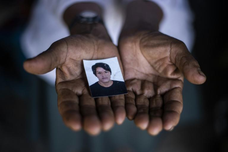 Angelica Lapa with a photo of her son Luis Fernando, killed in the attack on May 23 (AFP/ERNESTO BENAVIDES)