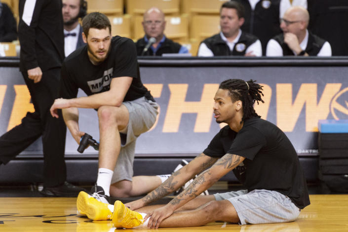 Missouri's Mitchell Smith, right, stretches with teammate Reed Nikko, left, before an NCAA college basketball game against Mississippi State Saturday, Feb. 29, 2020, in Columbia, Mo. (AP Photo/L.G. Patterson)