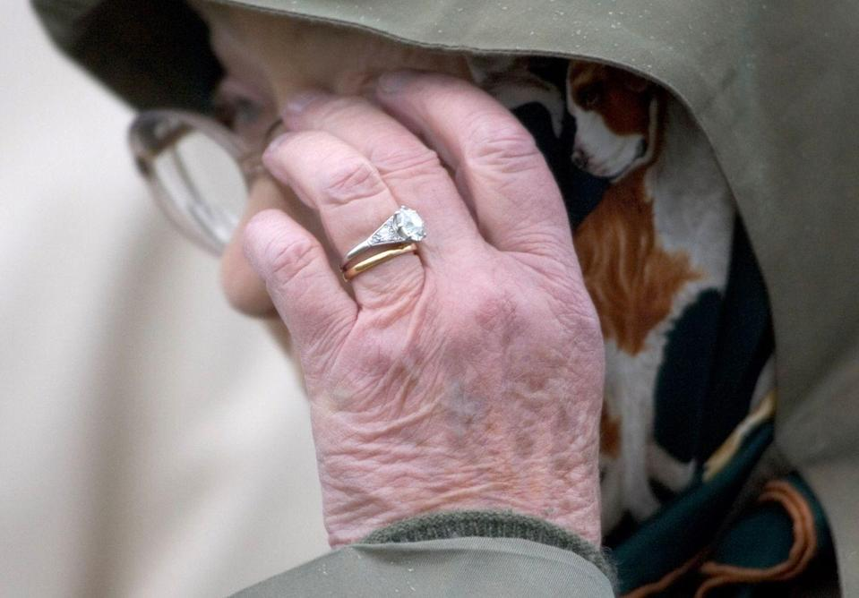 """<p>Prince Philip sourced the stones for Queen Elizabeth's engagement ring <a href=""""https://www.vogue.com/slideshow/british-royal-family-engagement-rings"""" rel=""""nofollow noopener"""" target=""""_blank"""" data-ylk=""""slk:from his mother's tiara"""" class=""""link rapid-noclick-resp"""">from his mother's tiara</a>. The classic mid-century design includes a square-cut center diamond and two side diamonds set in platinum. The Queen still wears the ring to this day—73 years later—with her Welsh gold wedding band. </p>"""
