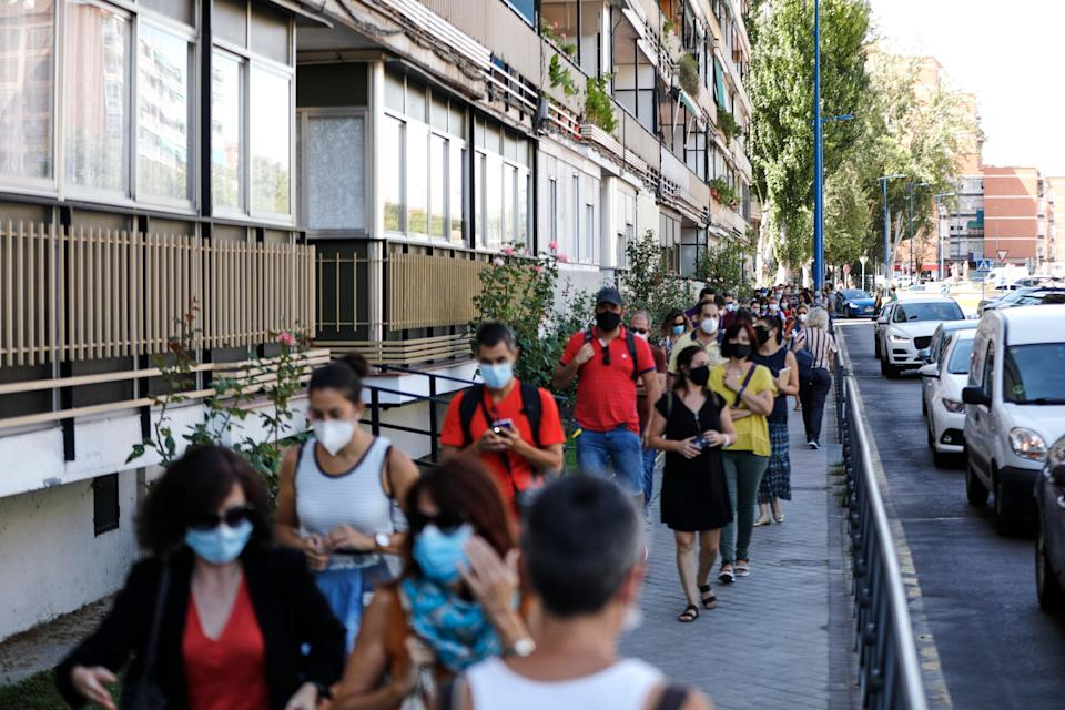 Teachers and administrative staff wait near the María Zambrano Secondary School for coronavirus tests on Sept. 3 in Madrid.There have been reports of people having to wait for days to more than a week for results. (Photo: Europa Press News via Getty Images)