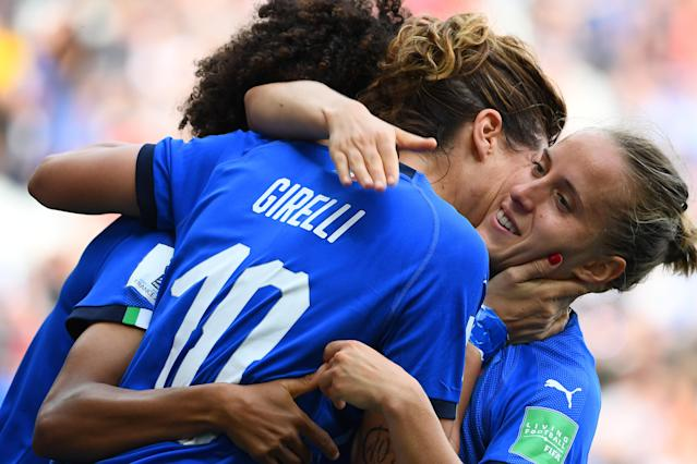 Italy's forward Cristiana Girelli (C) is congratulated by teammates after scoring a goal during the France 2019 Women's World Cup Group C football match between Jamaica and Italy, on June 14, 2019, at the Auguste-Delaune Stadium in Reims, eastern France. (Photo by FRANCK FIFE / AFP) (Photo credit should read FRANCK FIFE/AFP/Getty Images)