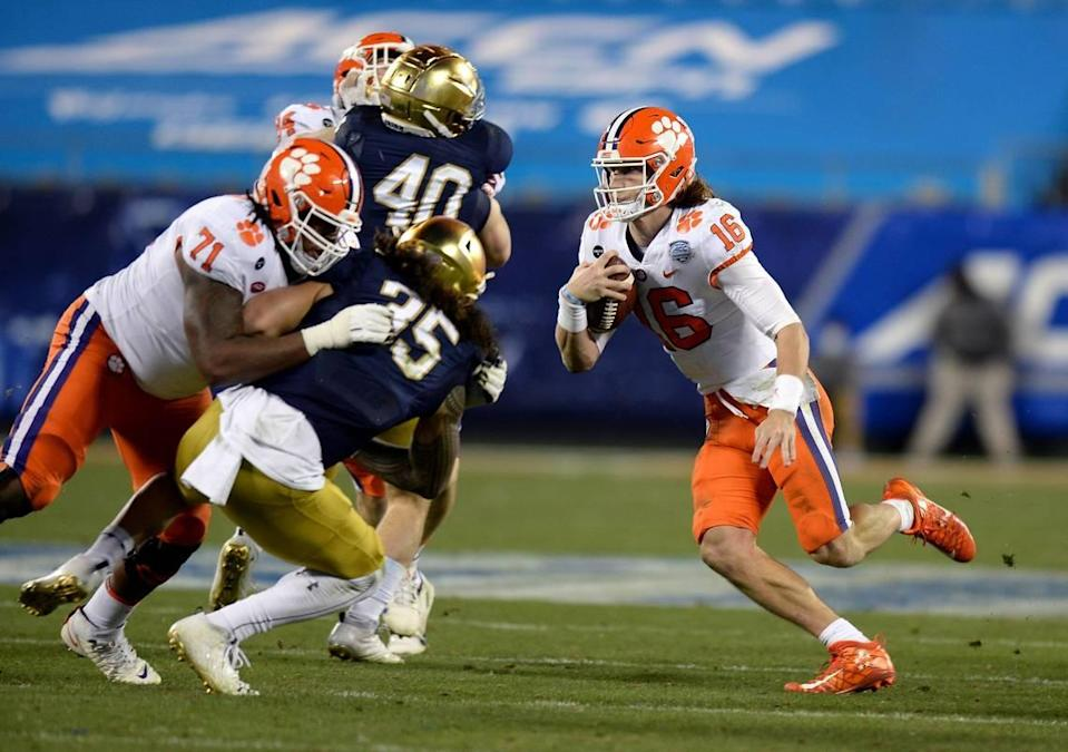 Former Clemson quarterback Trevor Lawrence rushes for a touchdown during the third quarter of the ACC Championship game against Notre Dame last December in Charlotte.