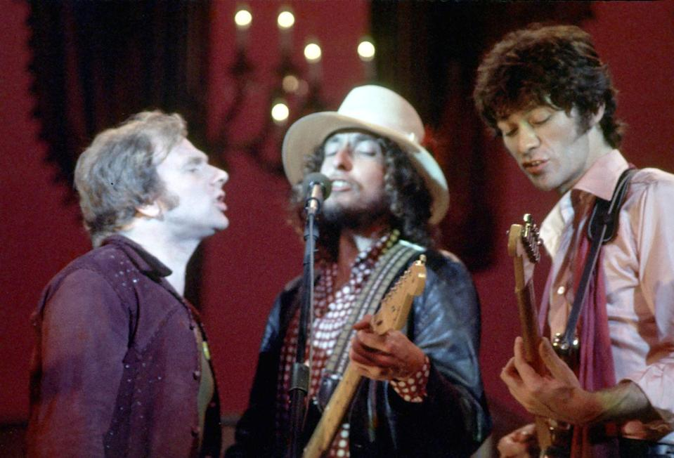 <p>Van Morrison, Bob Dylan, and Robbie Robertson perform on stage for The Band's The Last Waltz concert at the Winterland Ballroom on November 25, 1976 in San Francisco.</p>