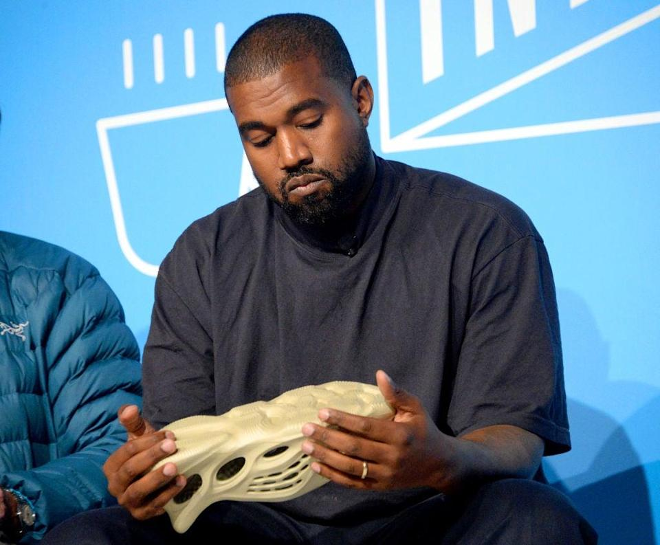 West is at pains to bring a pair of Arafats along to his press engagements, often waving them around or placing them in front of the camera (Getty Images for Fast Company)