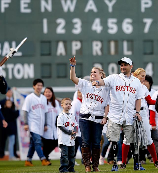BOSTON, MA - APRIL 20: Marc Fucarile, survivor of the 2013 Boston Marathon bombing, and his wife Jen Regan react during a ceremony at Fenway Park before a game between Boston Red Sox and the Baltimore Orioles at Fenway Park on April 20, 2014 in Boston, Massachusetts. (Photo by Jim Rogash/Getty Images)