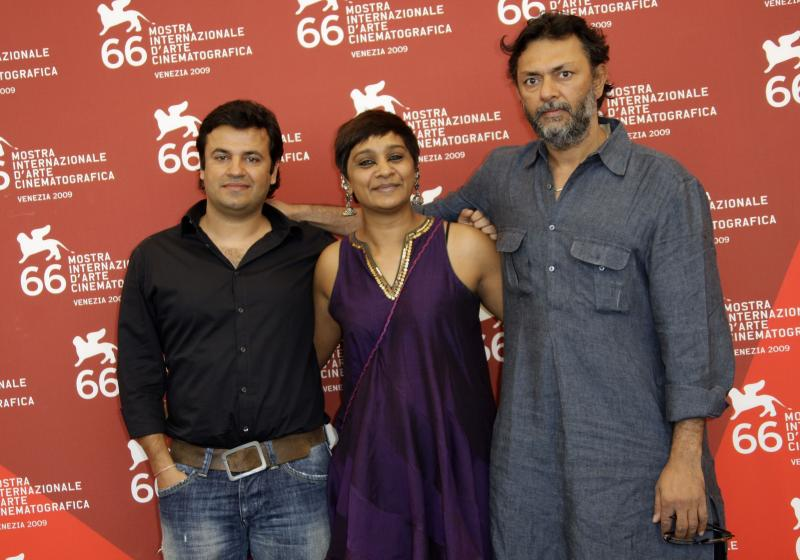 FILE - In this Sept. 9, 2009 file photo, Bollywood producer Vikas Bahl, left, poses with editor Bharathi Mehra and director Rakeysh Omprakash Mehra during a photo call for the film 'Delhi 6' at the 66th edition of the Venice Film Festival in Venice, Italy. A complaint by a retired Bollywood actress living in the United States alleging sexual harassment on a 2008 movie set has galvanized women in India, but for the country's burgeoning #MeToo movement to reach broader swaths of society, a little-known labor law must be more aggressively implemented, lawyers and activists said Thursday, Oct. 11, 2018. On October 7, an unnamed former employee at Phantom Films writing in the Huffington Post described allegations she had made in 2015 against one of the company's partners, director Vikas Bahl, whom she said behaved inappropriately during a trip to Goa. (AP Photo/Joel Ryan, File)