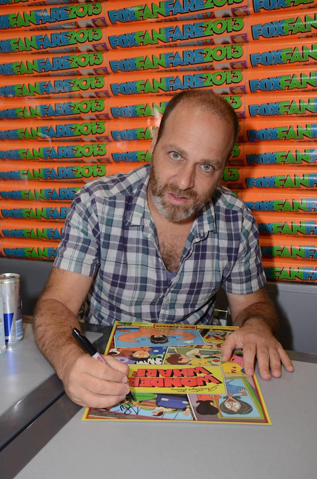 "H. Jon Benjamin signs an exclusive limited edition ""Bob's Burgers"" poster for fans on Friday, July 19 during Fox Fanfare At San Diego Comic-Con 2013."