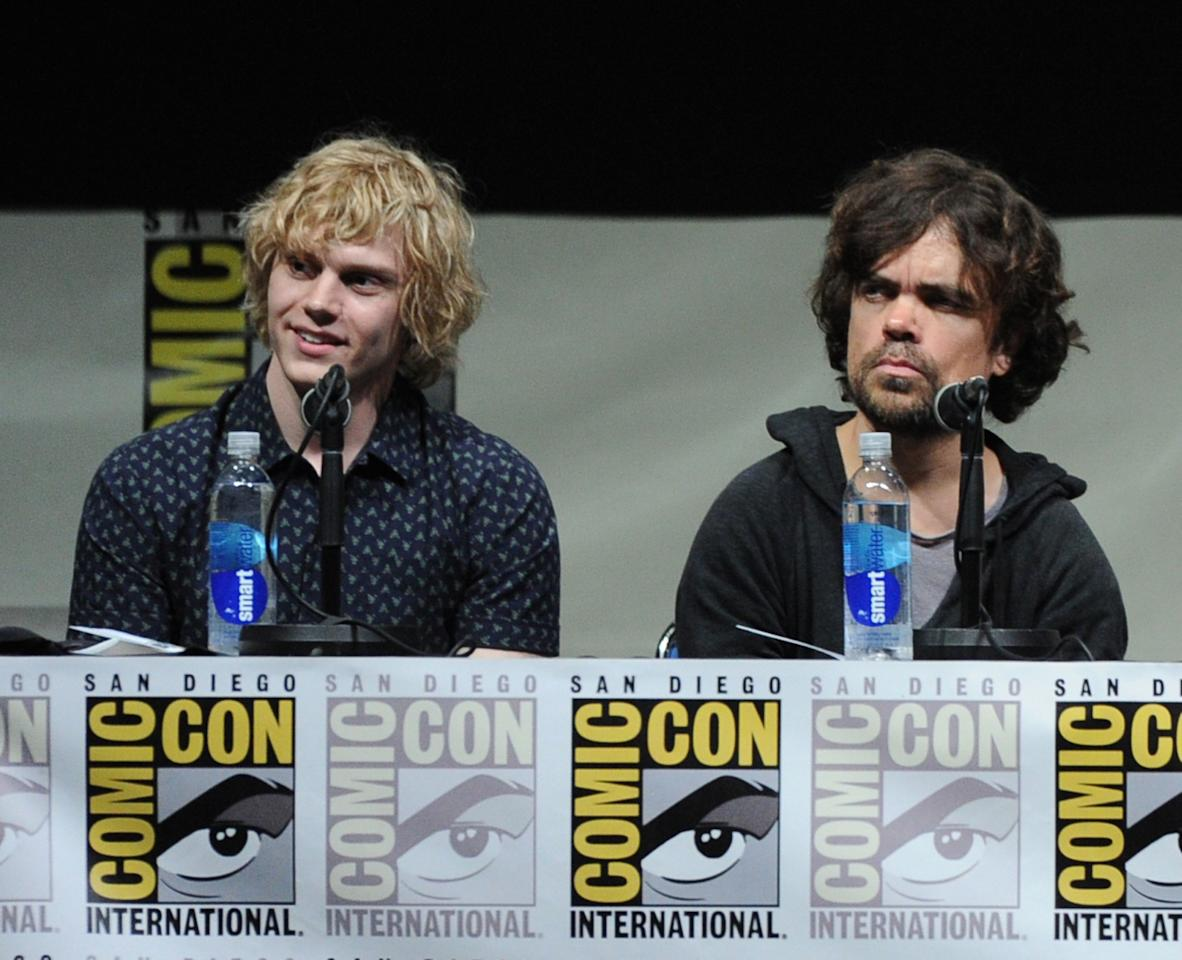 SAN DIEGO, CA - JULY 20: Actors Evan Peters (L) and Peter Dinklage speak at the 20th Century Fox panel during Comic-Con International 2013 at San Diego Convention Center on July 20, 2013 in San Diego, California. (Photo by Kevin Winter/Getty Images)