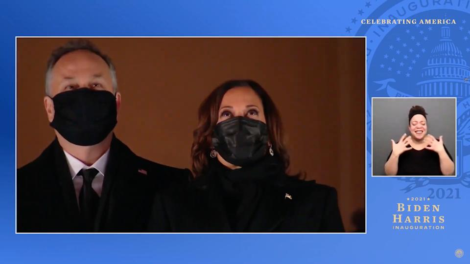 UNSPECIFIED - JANUARY 20: In this screengrab, Doug Emhoff and Vice President Kamala Harris watch fireworks during the Celebrating America Primetime Special on January 20, 2021. The livestream event hosted by Tom Hanks features remarks by president-elect Joe Biden and vice president-elect Kamala Harris and performances representing diverse American talent.  (Photo by Handout/Biden Inaugural Committee via Getty Images )