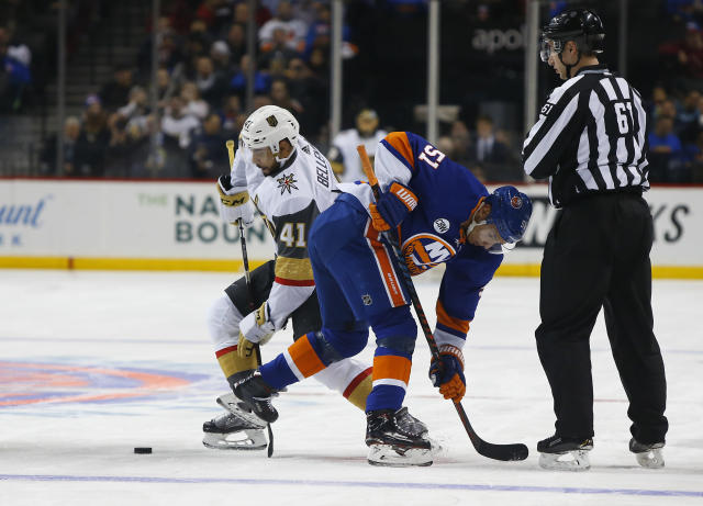 Vegas Golden Knights center Pierre-Edouard Bellemare (41) and New York Islanders center Valtteri Filppula (51) battle for the puck after a face off during the first period of an NHL hockey game, Wednesday, Dec.12, 2018, in New York. (AP Photo/Noah K. Murray)