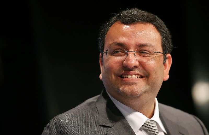 FILE PHOTO: Mistry, chairman of Tata Group, smiles during the TCS annual general meeting in Mumbai