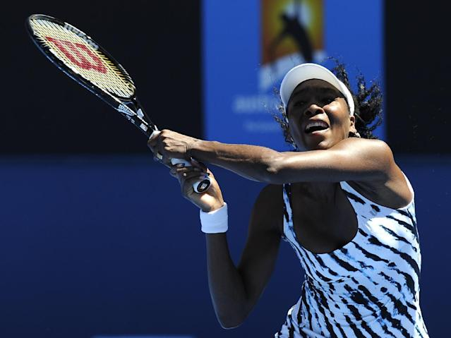Venus Williams of the U.S. makes a backhand return to Ekaterina Makarova of Russia during their first round match at the Australian Open tennis championship in Melbourne, Australia, Monday, Jan. 13, 2014. (AP Photo/Andrew Brownbill)