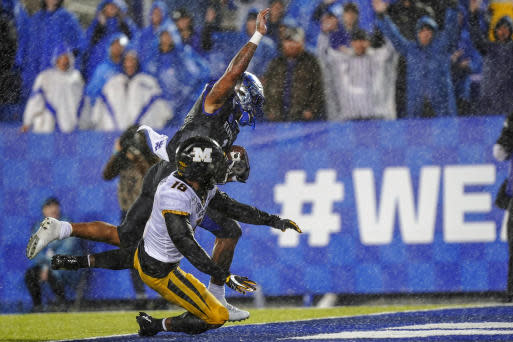 Kentucky quarterback Lynn Bowden Jr. (1) is tackled by Missouri safety Joshuah Bledsoe (18) as he scores a touchdown during the second half of NCAA college football game, Saturday, Oct. 26, 2019, in Lexington, Ky. (AP Photo/Bryan Woolston)