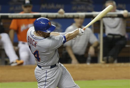 New York Mets' John Buck (44) hits a two-run home run in the fourth inning during a baseball game against the Miami Marlins, Monday, April, 29, 2013 in Miami. (AP Photo/Lynne Sladky)