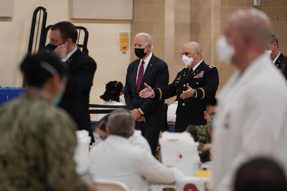 President Joe Biden tours the COVID-19 vaccine center at Walter Reed National Military Medical Center, with Col. Andrew Barr, Director of the Walter Reed National Military Medical Center, Friday, Jan. 29, 2021, in Bethesda, Md. (AP Photo/Alex Brandon)